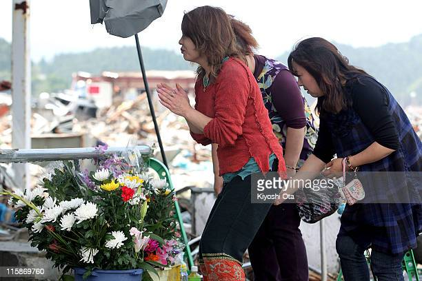 People pray for the earthquake and tsunami victims on June 11 2011 in Minamisanriku Miyagi Japan The Japanese government has been struggling to deal...