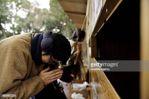 People pray for the New Year at the Meiji Shrine on January 1 in Tokyo Japan Japanese go to shrines to ask for health wealth and divine protection...