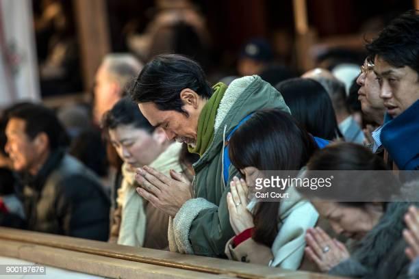 People pray for the new year at Tsurugaoka Hachimangu Shinto shrine on January 1 2018 in Kamakura Japan 'Hatsumode' is the first Shinto shrine visit...