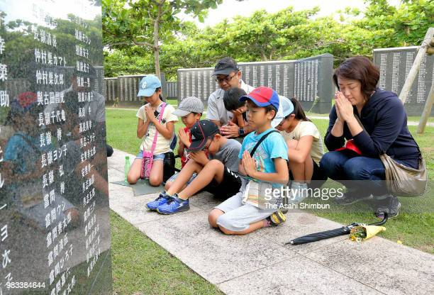 People pray for the victims at the Cornerstone of Peace where the names of their bereaved family members and relatives engraved at the Peace Memorial...