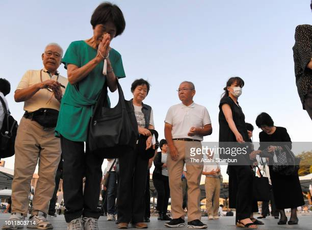 People pray for the victims in front of the cenotaph prior to the Peace Memorial Ceremony at Hiroshima Peace Memorial Park on the 73rd anniversary of...