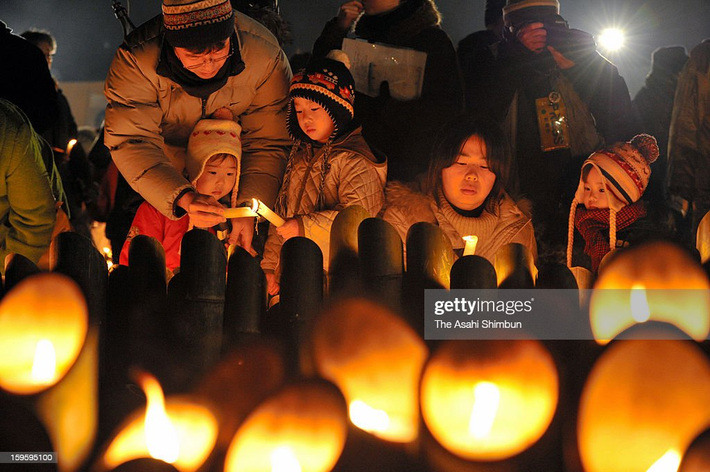 People pray for the victims of 1995's Great Hanshin Earthquake at Higashi Yuenchi park on January 17, 2013 in Kobe, Hyogo, Japan. Memorial services were held to mark the 18th anniversary of the 1995 massive earthquake, hundreds of people gathered early this morning to pay their respects and light bamboo lanterns in the park for more than 6,400 people who lost their lives in the 7.3 magnitude earthquake.