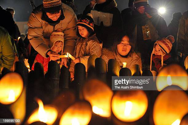 People pray for the victims of 1995's Great Hanshin Earthquake at Higashi Yuenchi park on January 17 2013 in Kobe Hyogo Japan Memorial services were...