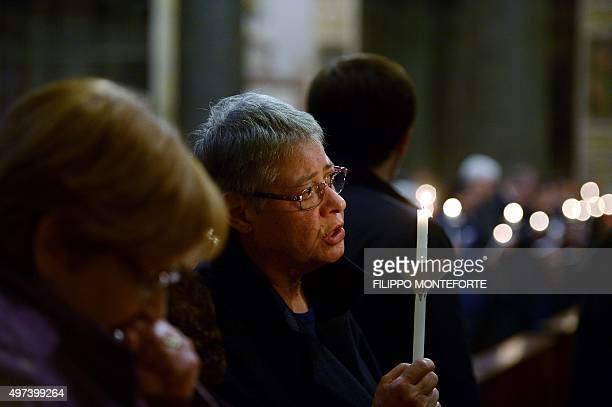 People pray for the victims of Paris attacks inside Santa Maria in Trastevere Basilica in Rome on November 16 2015 Islamic State jihadists claimed a...