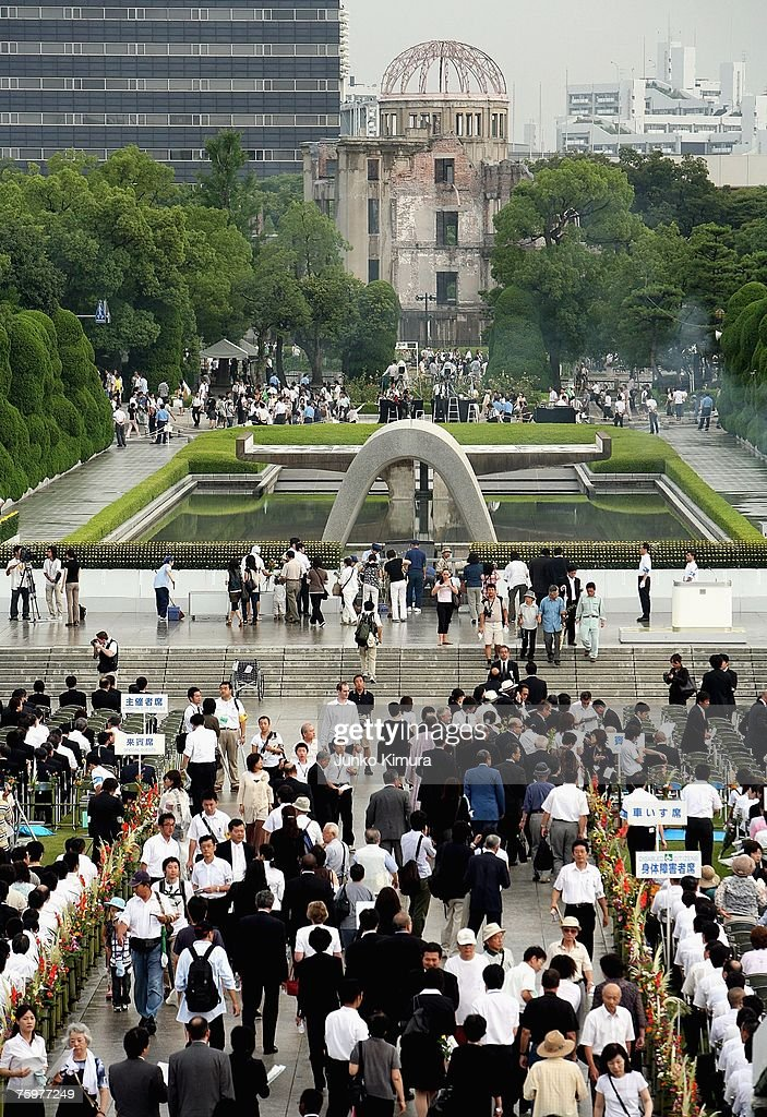 People pray for the victims of the atomic bomb at the Peace Memorial Park on August 6, 2007 in Hiroshima. Japan. The dropping of the atomic bomb by the U.S. killed an estimated 70,000 people instantly on August 6, 1945 with many thousands more dying over the following years from the effects of radiation. Three days later another atomic bomb was dropped on Nagasaki, ending World War II.