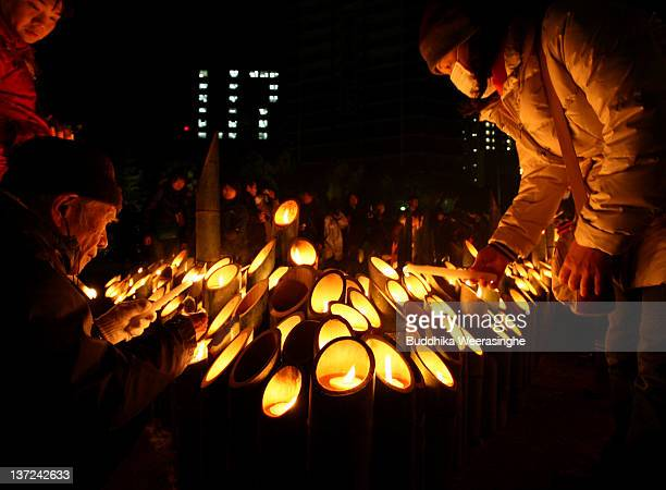People pray for the victims of the Kobe Great Earthquake during a memorial ceremony to commemorate the 17th anniversary of the 1995 Great Hanshin...