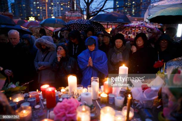 People pray for the victims of the mass killing at a vigil on April 24 2018 in Toronto Canada A suspect identified by police as Alek Minassian is in...