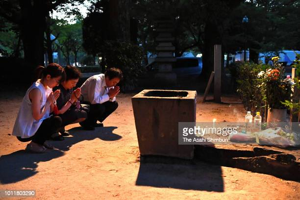 People pray for the victims prior to the Peace Memorial Ceremony at Hiroshima Peace Memorial Park on the 73rd anniversary of the Hiroshima ABomb...