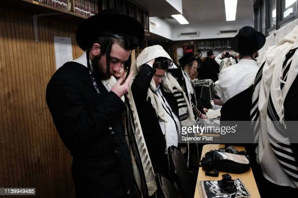 People pray in a yeshiva as thousands of mourners gather in Borough Park for the funeral of The Skulener Rebbe Rabbi Yisroel Avrohom Portugal who...
