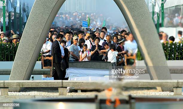 People pray in front of the cenotaph during the memorial ceremony on the 70th anniversary of the Hiroshima Atomic Bomb at Hiroshima Peace Memorial...