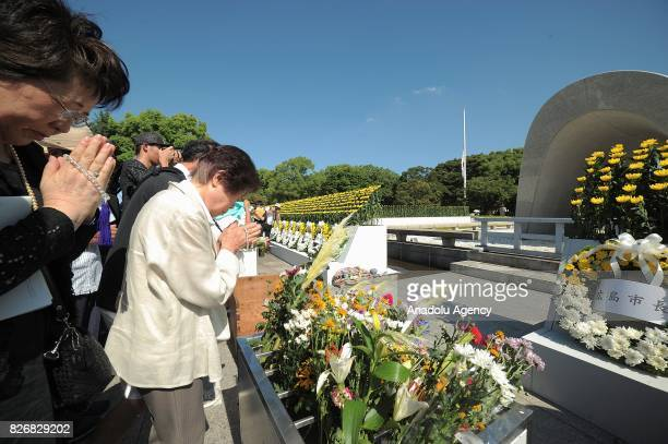 People pray in front of the Cenotaph for the Bomb Victims on August 6 2017 in Hiroshima Japan Japan marks the 72nd anniversary of the first atomic...
