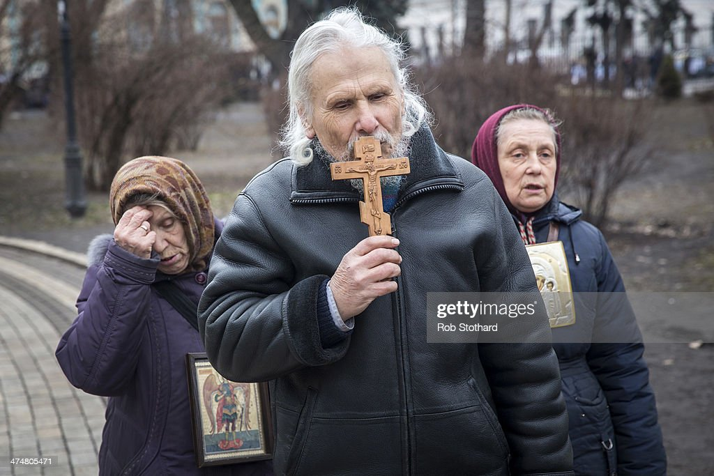 People pray in Mariyinsky park on February 25, 2014 in Kiev, Ukraine. Ukraine's interim President Olexander Turchynov is due to form a unity government, as UK and US foreign ministers meet to discuss emergency financial assistance for the country.