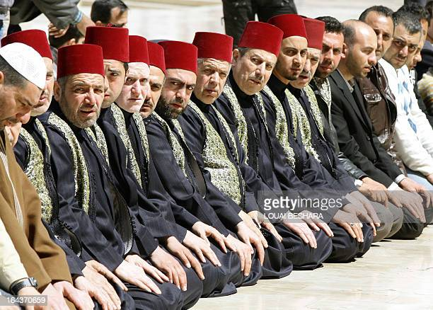 People pray in the Omayyad mosque courtyard during the funeral ceremony of Sunni Muslim cleric Mohamed Saeed alBouti who died in a suicide bomb...