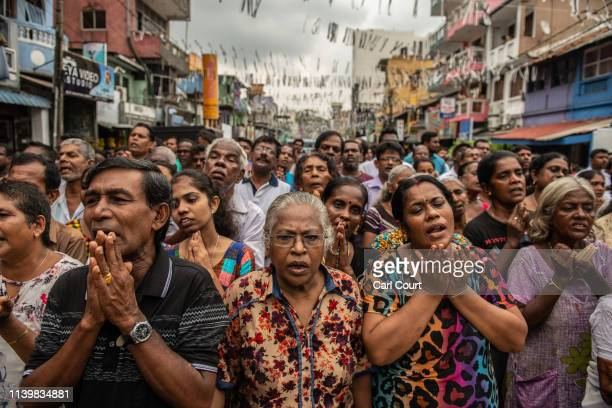 People pray in the street near St Anthony's Shrine one week on from the attacks that killed over 250 people on April 28 2019 in Colombo Sri Lanka At...