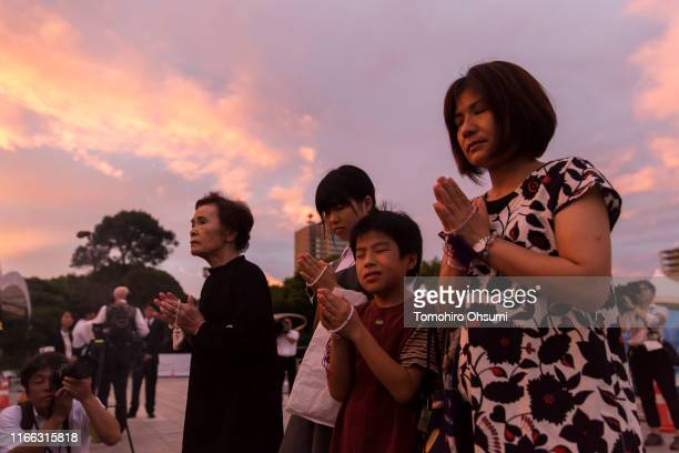 People pray on the 74th anniversary of the atomic bombing of Hiroshima at the Hiroshima Peace Memorial Park on August 6 2019 in Hiroshima Japan Japan...