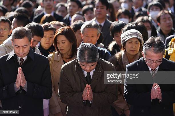 People pray on the first day of business in 2016 at the Kanda Myojin shrine in Tokyo Japan on Monday Jan 4 2016 Japanese stocks tumbled with the...