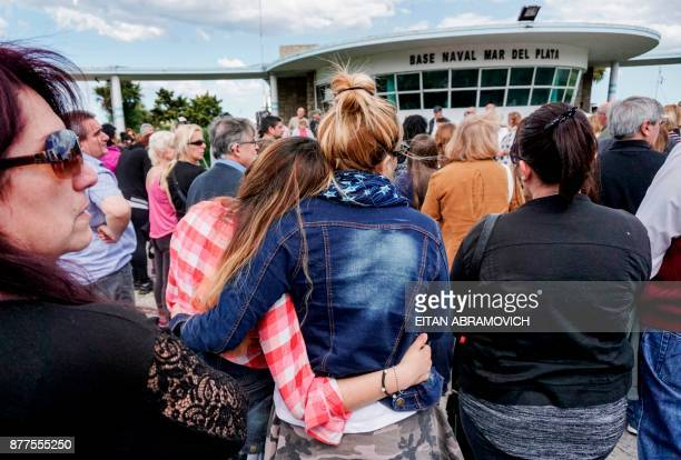 People pray outside Argentina's Navy base in Mar del Plata on the Atlantic coast south of Buenos Aires on Novembe 22 while the search for the missing...
