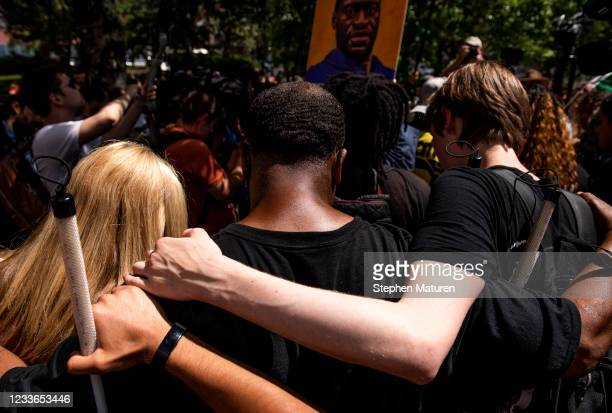 People pray outside the Hennepin County Government Center after Judge Peter Cahill announced the sentencing of Derek Chauvin on June 25, 2021 in...