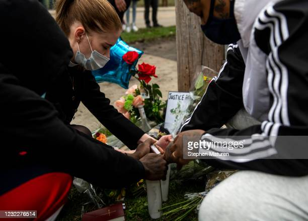 People pray over candles during a vigil for Daunte Wright on April 12, 2021 in Brooklyn Center, Minnesota. Wright was shot and killed yesterday...