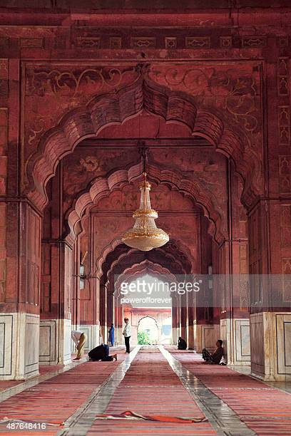 people praying at jama masjid - old delhi, india - jama masjid delhi stock pictures, royalty-free photos & images