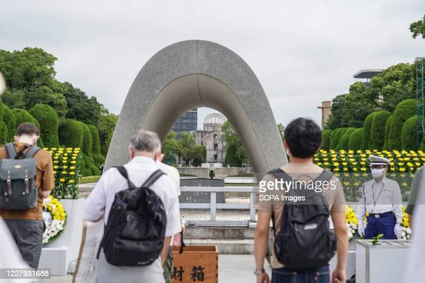 People praying at the Hiroshima Peace Memorial Ceremony Hiroshima marks the 75th anniversary of the US atomic bombing which killed about 150000...