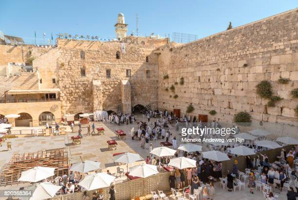 People praying at the Wailing Wall, at the Western Wall Plaza, in the  the Old City of Jerusalem, Israel.