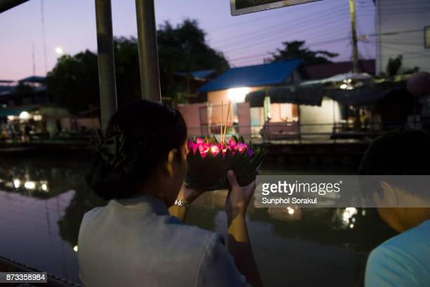 People praying before placing Floating Lanterns in river for Loy Krathong festival