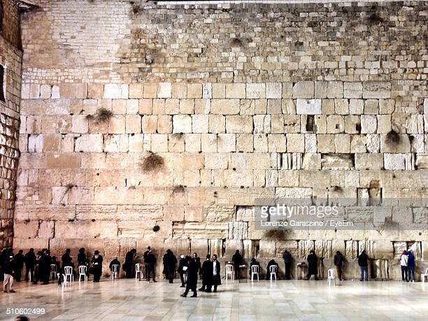 People praying by the Western Wall