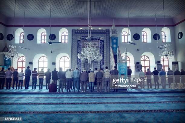 people praying in çarşı(market) mosque in buldan,denizli province. - emreturanphoto stock pictures, royalty-free photos & images