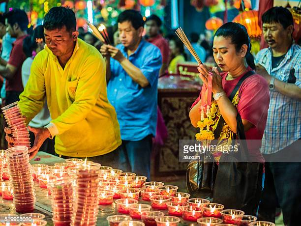 People praying in Bangkok Thailand