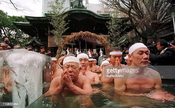 People Praying In Icebath At Teppozu Inari For Good Health And Safe Family Life In Tokyo Japan On January 09 2000 Masamitsu Nakagawa 92 years old