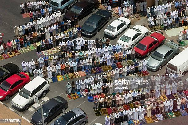 People praying near a mosque