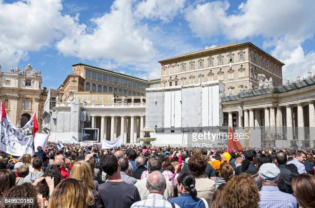 People praying together with Pope Francis in his usual Sunday Angelus prayer in St Peter's Square
