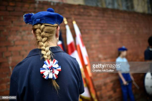 People prepare as the annual 12th of July Orange march and demonstration takes place on July 12 2018 in Belfast Northern Ireland The marches across...
