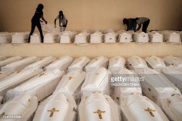 People prepare coffins containing newly discoverd remains of 84437 victims of the 1994 genocide before a funeral ceremony at the Nyanza Genocide...