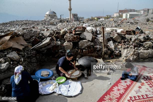TOPSHOT People prepare food after arriving in Sirnak city on November 14 after a 246day curfew was partially lifted The curfew in Sirnak a city of...