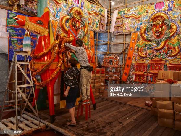 People prepare paper statues and joss paper offerings during the month of Hungry Ghost Festival on August 10 2018 in Hong Kong The Yu Lan Festival...