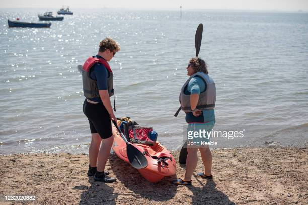 People prepare take to the water in a kayak on March 30, 2021 in Southend, United Kingdom. Despite todays temperature heading towards 24 degrees,...