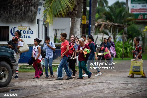 People prepare to be evacuated in Teacapan Sinaloa state Mexico on October 22 before the arrival of Hurricane Willa Hurricane Willa was upgraded to a...