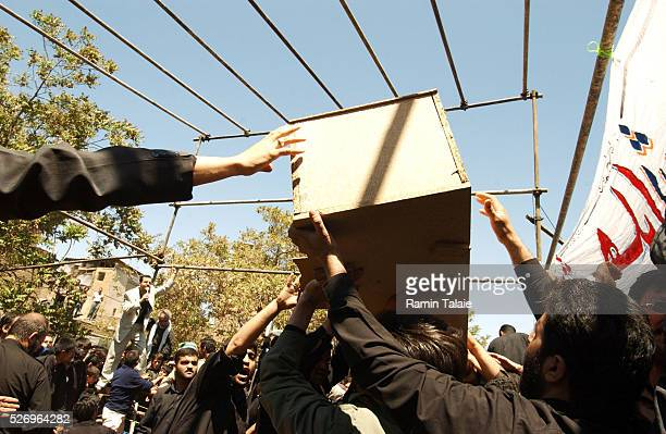 People prepare to bury the dead at a ceremony coinciding with a Shiite holy day 12 years after the end of IranIraq war and up to the start of...