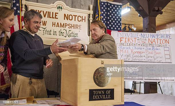 people prepare to cast their ballots at a polling station at midnight on November 6 2012 in Dixville Notch New hampshire the very first voting to...