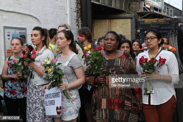 People prepare to lay flowers outside the Muslim Welfare House near the scene of the attack by Finsbury Park Mosque on June 19 2017 in London England...
