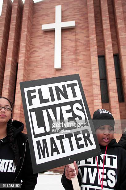People prepare to participate in a national milelong march to highlight the push for clean water in Flint February 19 2016 in Flint Michigan The...