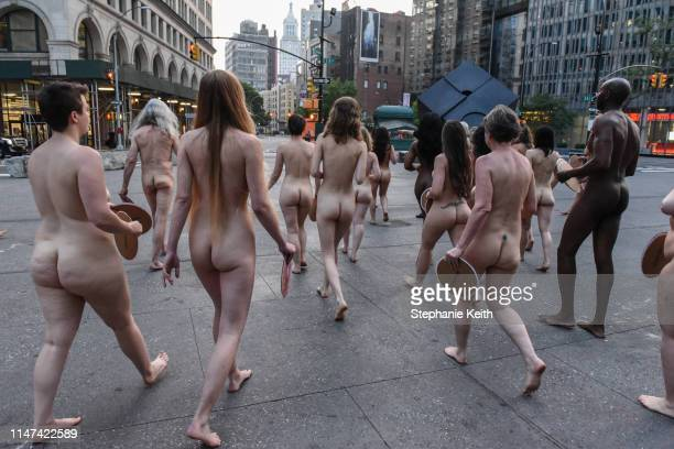 People prepare to pose nude holding cut outs of nipples during a photo shoot by artist Spencer Tunick on June 2 2019 in New York City Spencer Tunick...