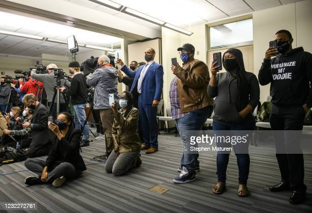 People prepare to watch the body camera footage of the killing of 20-year-old Daunte Wright is played during a press conference at the Brooklyn...