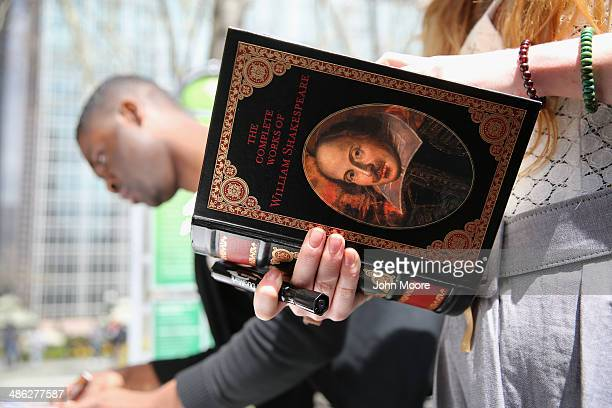 People prepare to write favorite quotes on a Shakespeare word canvas on April 23 2014 in Bryant Park in New York City Lovers of the Bard marked...