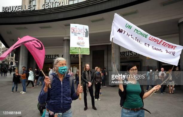 People protest against 5G infrastructure investments at Central Station in Brussels, Belgium on July 04, 2020.