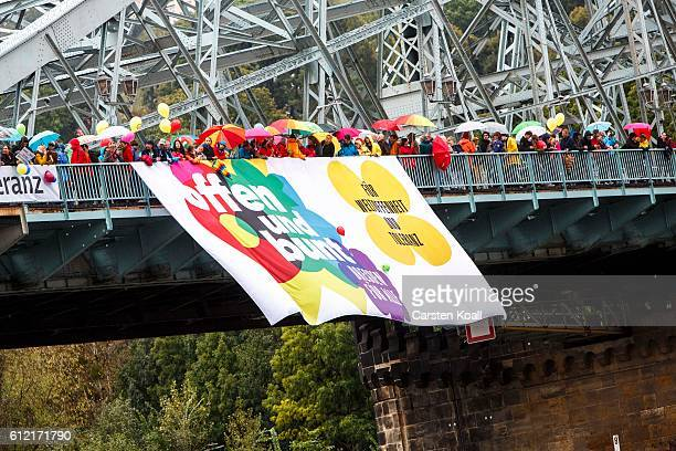 People protest against a ralley of right wing citizens movement 'Festung Europa' on German Unity Day on October 3 2016 in Dresden Germany Unity Day...