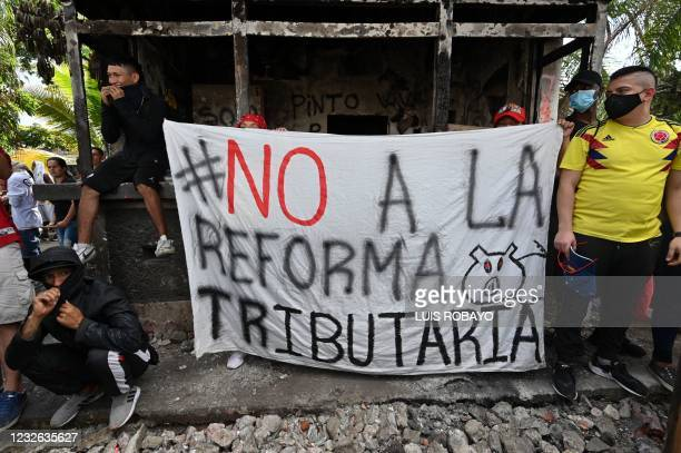 People protest against a tax reform bill they say will leave them poorer as the country battles its deadliest phase yet of the coronavirus pandemic,...