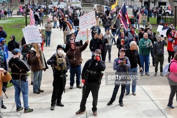 People protest against excessive quarantine amid the coronavirus pandemic at the Michigan State Capitol in Lansing Michigan on April 15 2020 The...